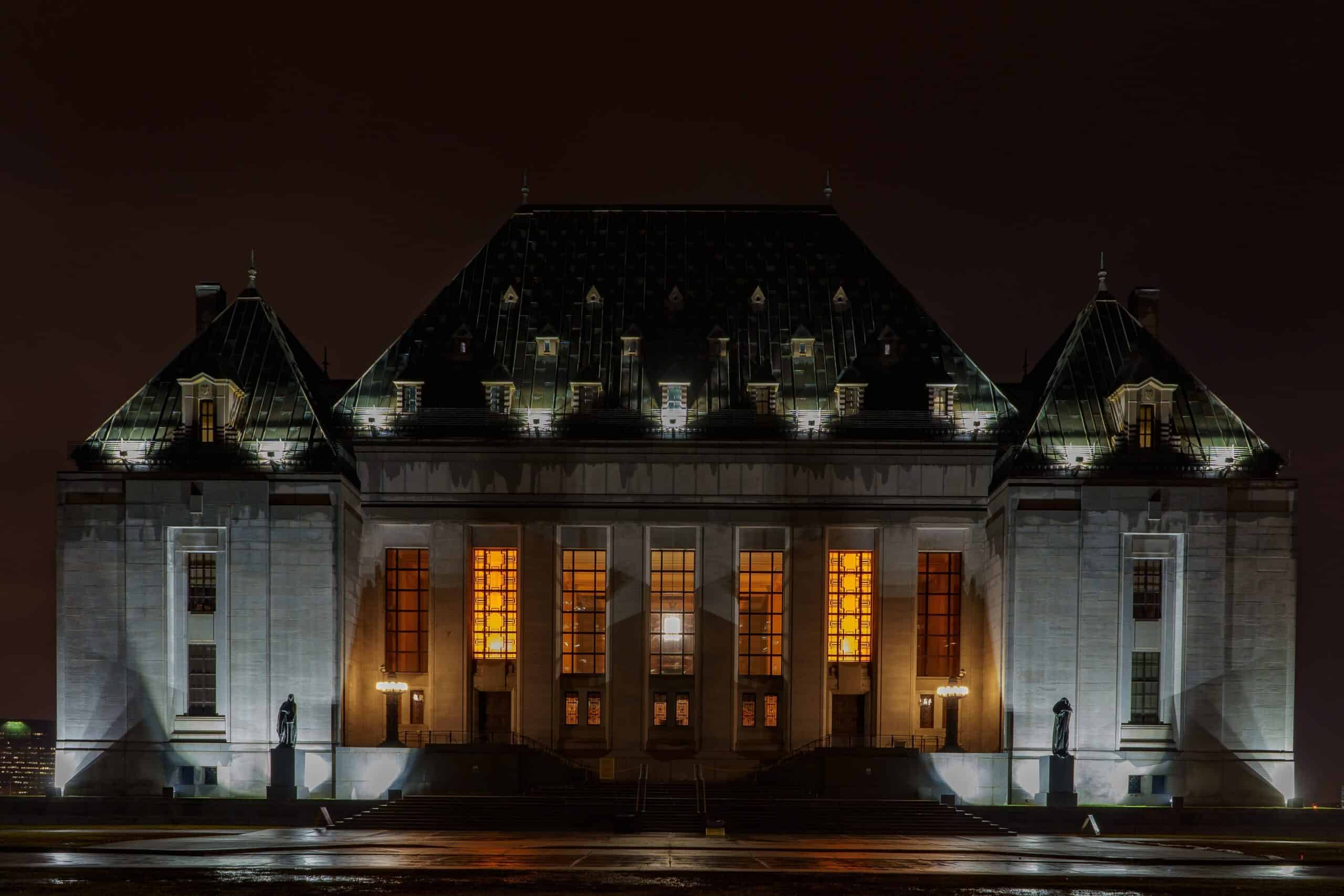 the Supreme Court building at night